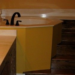 Japanese style tub with steps leading to the tub