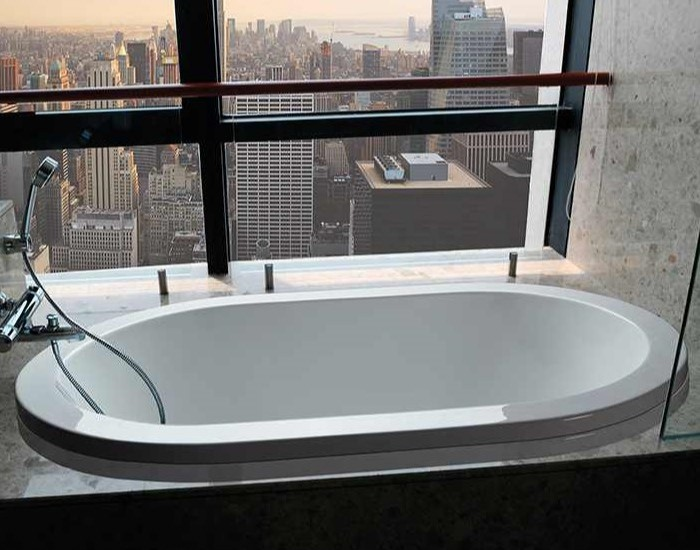 New Yorker shown as a drop-in soaking tub with a wall mounted tub filler