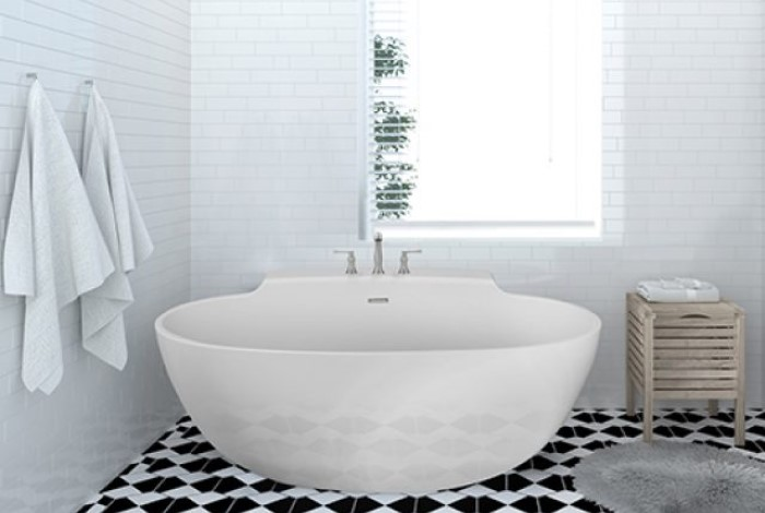 Freestanding Oval Bath with Curving Sides, Extended Deck with Faucets Installed