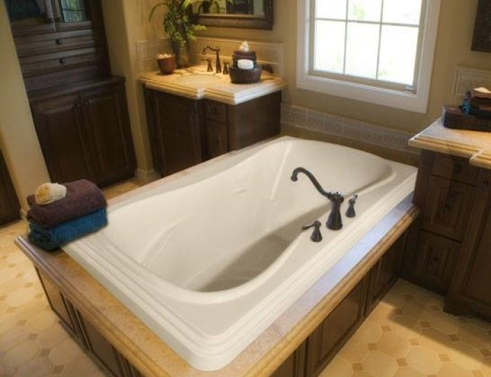 Jennifer Drop-in Bathtub Installed in a Tile and Wood Surround