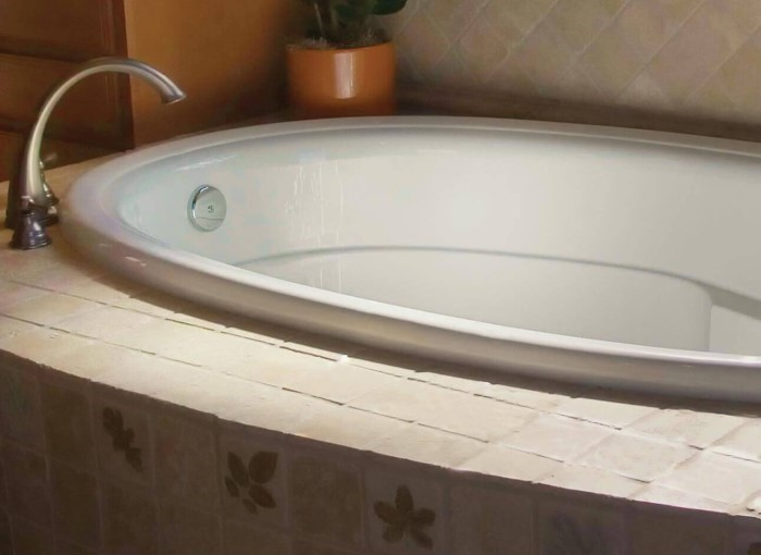 Riley Drop-in Tub Installed, Showing Decorative Rim and Interior Molding