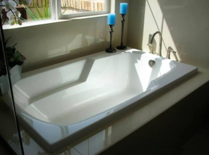 Solo Soaking Bath Installed as a Drop-in Tub, Modern Armrests