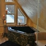 Black Corner Tub with Rock Tile