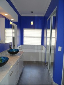 Blue and White Bathroom with Gray Floor