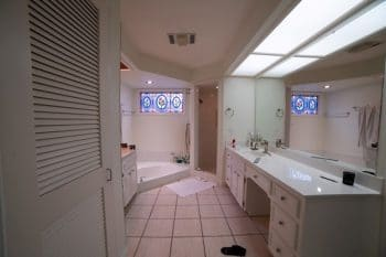 Traditional Bathroom with a recessed tub, long counter and small shower