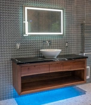 Wood wall vanity, stone top and vessel sink