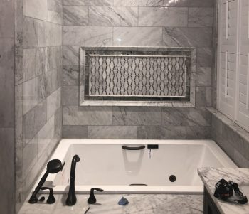 White Rectangle Tub with Oil Rubbed Bronze Jets and Grab Bar