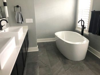 Oval Freestanding Bath with Floor Mounted Tub Filler in Bronze