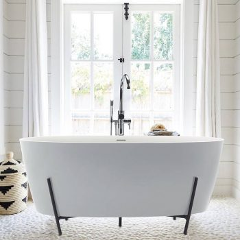 Freestanding tub is nestled in a hand-made steel cradle