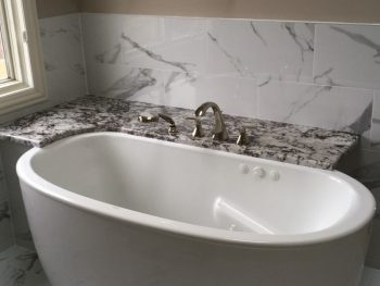 Close Up of Bath with Armrests and Water Jets